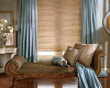 The slats on wood blinds come in many shades to work with your room's decor.