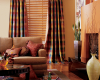 Wood blinds work well with fabric draperies such as these colourful side panels.