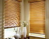 The filtered light offered by wood blinds creates a warm feeling.