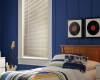 The brushed nickel aluminum blinds in this bedroom add a touch of sleekness.