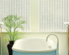 Cadence soft vertical blinds offer privacy in this bathroom.
