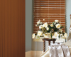 Wood vertical blinds can be combined with wood blinds in a room.