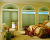 Arched windows and room darkening fabrics make Hunter Douglas Applause cellular shades a great choice for this bedroom.