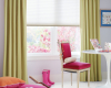 Hunter Douglas Design Studio Roman shades work in this room with the colours and contrasting side panels.