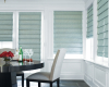 Hunter Douglas Design Studio Roman shades add dimension to the windows in this dining room.