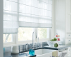 Sheer Hunter Douglas Design Studio Roman shades add sun control to this bright kitchen window but allow the view.