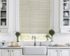 Since they are resistant to moisture, Hunter Douglas Everwood Faux Wood blinds work in a kitchen or bathroom.