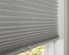 Hunter Douglas Pleated shades can be mounted inside the window frame for a sleek, clean look.