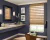 The natural colours of the Hunter Douglas Provenance Woven wood shades in this bathroom add an earthy element to the design.