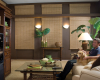 Media rooms can benefit from the room darkening fabrics of Hunter Douglas Provenance Woven wood shades.