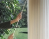 Hunter Douglas Luminette sheers can be stacked using a wand to move the sheers to one side of the window.