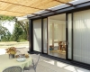 Large sliding glass doors get an elegant treatment with Hunter Douglas Luminette sheers.