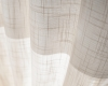 Hunter Douglas Luminette sheers are available in many fabrics such as this linen-weave one.