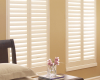 Hunter Douglas Palm Beach polysatin shutters add a beach house vibe to any room.