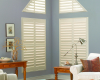 Hunter Douglas Palm Beach polysatin shutters can be manufactured to fit angled windows like the ones in this photo.