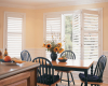 Hinged panels allow you to fold your Hunter Douglas Palm Beach polysatin shutters off the window glass for an unobstructed view.