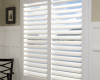 These Hunter Douglas Palm Beach polysatin shutters have the Lantana, gear driven operating system.