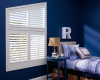 These Hunter Douglas Palm Beach polysatin shutters accentuate the angled window in this room.