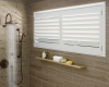 Vinyl shutters can offer privacy and durability in a bathroom.