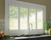 These Hunter Douglas Palm Beach polysatin shutters are installed with a bi-fold track so they can be folded off the window glass.