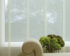 Hunter Douglas Skyline Gliding Window Panels are available in sheer fabrics such as the one shown so you don't have to sacrifice your view.