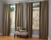 Hunter Douglas Vignette Modern Roman Shades pair beautifully with side panels in this bedroom.