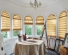 Hunter Douglas Vignette Modern Roman Shades can be manufactured to fit curved eyebrow windows.