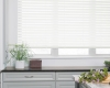 These faux wood blinds come in a selection of white and off-white finishes.