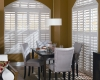 Vinyl shutters are stylish enough to use in your dining room.