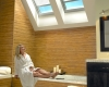 Skylights in bathrooms can be treated with automated cellular shades.