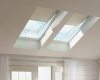 Roller shades help to control the light and heat entering through this skylight.