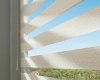 When operated, the sheer and solid fabric bands of the Hunter Douglas Designer Banded Shades transition effortlessly by each other.