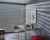 Hunter Douglas Designer Banded Shades combine sheer and solid fabrics into a single shade.