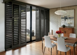Hunter Douglas NewStyle Hybrid Shutters TruView Bypass Track Dining Room